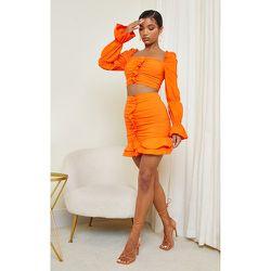 Mini-jupe froncée en maille tissée stretch à volants - PrettyLittleThing - Modalova