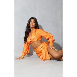 Mini-jupe asymétrique satinée imprimée à côté noué - PrettyLittleThing - Modalova