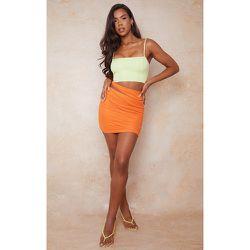 Mini-jupe froncée à découpes et nouée sur le côté - PrettyLittleThing - Modalova