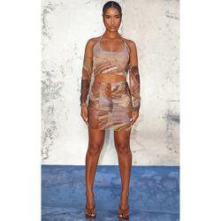 Mini-jupe en mesh transparent imprimé abstrait à coutures surjetées - PrettyLittleThing - Modalova