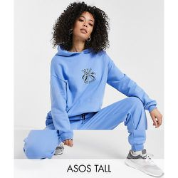 ASOS DESIGN Tall - Survêtement oversize avec hoodie et jogger à motif ski - Bleu - ASOS Tall - Modalova