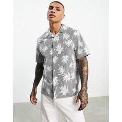 Chemise à manches courtes avec imprimé palmier sur l'ensemble - Calvin Klein Jeans - Modalova