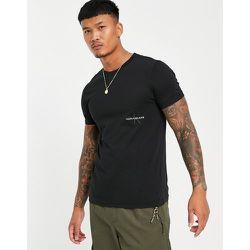 T-shirt à logo emblématique excentré - Calvin Klein Jeans - Modalova