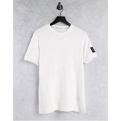 T-shirt en tissu gaufré avec écusson monogramme - Calvin Klein Jeans - Modalova