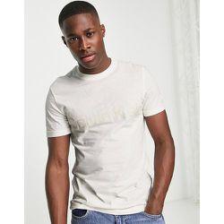 T-shirt à logo superposé - Crème - Calvin Klein - Modalova