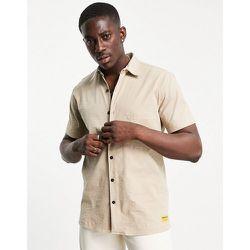Caterpillar - Chemise manches courtes avec poche et logo - Camel - Cat Footwear - Modalova