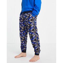 Jogger confort avec petit logo à motif camouflage - Bleu marine - Tommy Hilfiger - Modalova