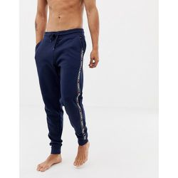 Pantalon de jogging confort authentique resserré aux chevilles à bandes griffées sur les côtés - Bleu - Tommy Hilfiger - Modalova