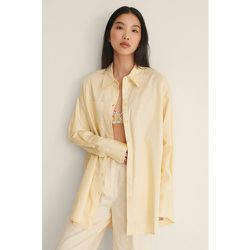 Recyclée chemise surdimensionnée à poches - Yellow - NA-KD Trend - Modalova